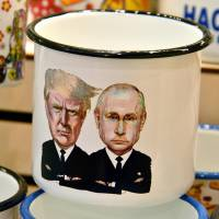 A mug depicting Russian President Vladimir Putin and U.S. President Donald Trump is displayed at a souvenir shop in Moscow on Wednesday. | AFP-JIJI