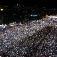 Turks marks a year since failed coup as Erdogan vows to 'rip heads off' terrorists and plotters