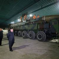 North Korean leader Kim Jong Un inspects the intercontinental ballistic missile Hwasong-14 in this undated photo released by North Korea's Korean Central News Agency in Pyongyang on Wednesday. | KCNA / VIA REUTERS
