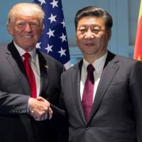 U.S. President Donald Trump and Chinese President Xi Jinping shake hands prior to a meeting on the sidelines of the Group of 20 Summit in Hamburg, Germany, on July 8. | REUTERS