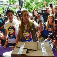 Maduro foes across Venezuela, expats worldwide cast plebiscite ballots against constitution rewrite
