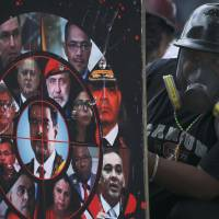 U.S. eyes financial sanctions to cut off Venezuela's oil revenue amid ongoing protests over Maduro