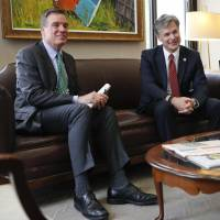 Sen. Mark Warner, D-Va. (left) meets with FBI Director nominee Christopher Wray in Warner's office on Capitol Hill in Washington July 13. | AP
