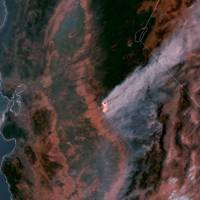 This satellite imagery posted Wednesday on a National Oceanic and Atmospheric Administration website shows a large plume of smoke spreading hundreds of miles east from the Ditwiler fire, near Yosemite National Park in California's Sierra Nevada. Authorities say the stubborn wildfire burning in foothills west of Yosemite had destroyed dozens of structures while forcing thousands of people from their homes Wednesday. | NATIONAL OCEANIC AND ATMOSPHERIC ADMINISTRATION / VIA AP