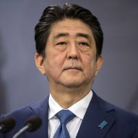 Prime Minister Shinzo Abe agreed Thursday to attend an ad hoc Diet committee session, which is likely to take place next week or later. | AP