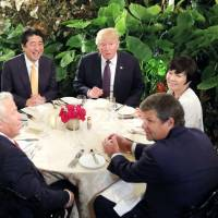 Akie Abe (right) attends dinner with U.S. President Donald Trump, Prime Minister Shinzo Abe and Trump's wife Melania at Mar-a-Lago Club in Palm Beach, Florida, on Feb. 10.   REUTERS