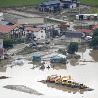 A flooded section of Daisen, Akita Prefecture, is viewed from the air on Monday. | KYODO