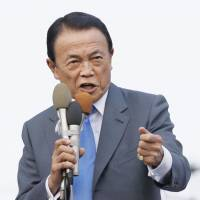 Aso's office admits deputy prime minister broke guidelines on golf club memberships