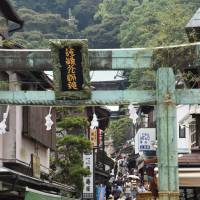 Tourism boom: Benzaiten Nakamise Street, at the entrance to the island of Enoshima in Fujisawa, Kanagawa Prefecture, is crowded with tourists.