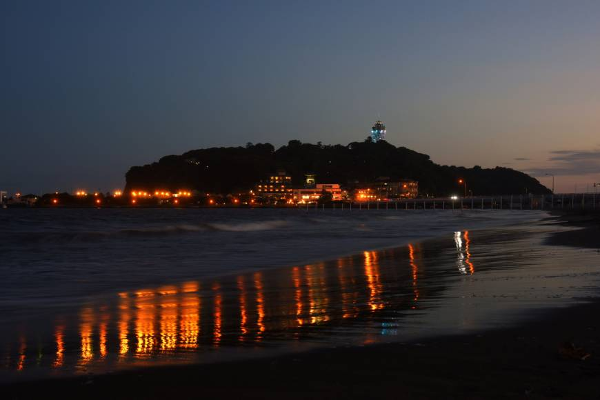 The lighthouse, known as Enoshima Sea Candle, is lit up on the night of July 14.