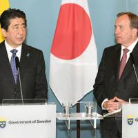 Prime Minister Shinzo Abe and his Swedish counterpart, Stefan Lofven, hold a news conference on Sunday in Stockholm.   KYODO