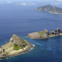 The Senkaku Islands in the East China Sea are seen in this file photo. Four Chinese coast guard ships entered Japanese territorial waters close to the islands, in Okinawa Prefecture, on Monday morning, according to the Japan Coast Guard. | KYODO