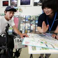 Man travels by wheelchair through Japan, propelled by the kindness of strangers