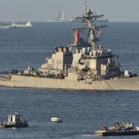 Japan ready to close probe of U.S. warship's collision; no input from Americans