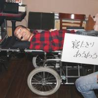 Asodog, who claims to be Japan's first and only 'bedridden' comedian, performs in Kumamoto in February. | KYODO