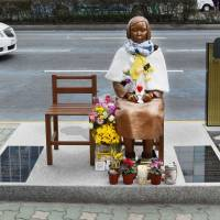 A statue of a girl symbolizing 'comfort women' is placed in front of the Japanese Consulate in Busan, South Korea, in March. | KYODO