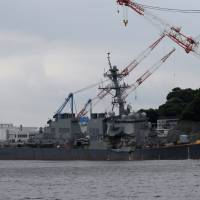 The Arleigh Burke-class guided-missile destroyer USS Fitzgerald, damaged in a collision with a Philippine-flagged merchant vessel, is seen at the U.S. naval base in Yokosuka on June 18. | REUTERS
