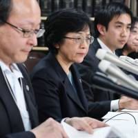 Lawyers representing a mother who is suing for custody of her daughter and limits on the father's visitation rights appear at a news conference in Tokyo in January. | KYODO
