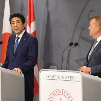 Prime Minister Shinzo Abe speaks during a joint news conference with his Danish counterpart Lars Lokke Rasmussen on Monday in Copenhagen. | KYODO