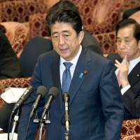 Prime Minister Shinzo Abe is grilled at an ad hoc session of the Lower House Budget Committee on Monday. | KYODO