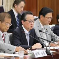 Hajime Funada (second from left), a Liberal Democratic Party lawmaker, speaks at a session of the Lower House's Commission on the Constitution. | KYODO