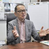 Takashi Maeno, the dean of the Graduate School of System Design and Management at Keio University, speaks about his studies on happiness during an interview at the university's campus in Yokohama in June. | YOSHIAKI MIURA