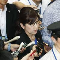 Defense Minister Tomomi Inada is seen surrounded by reporters Wednesday at the Defense Ministry. | KYODO