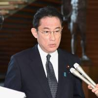 Foreign Minister Fumio Kishida fields questions from reporters after a regular Cabinet meeting at the Prime Minister's Office on Friday. | KYODO