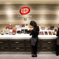 Employees arrange Kit Kat products at the Kit Kat Chocolatory Ginza store in Tokyo on July 24. | BLOOMBERG