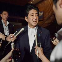 Prime Minister Shinzo Abe speaks with reporters at the Prime Minister's Office early Saturday morning, after a missile fired by North Korea lands in Japan's exclusive economic zone.   KYODO