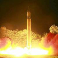An apparent North Korean long-range missile is launched Friday in an image taken from the Saturday edition of the Rodong Sinmun daily.   KYODO
