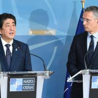 Japan, NATO look to expand cooperation at sea, in cyberspace