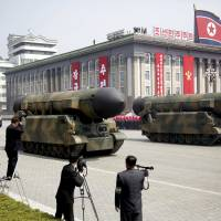 North Korean mobile missile canisters are displayed in Kim Il Sung Square in Pyongyang during a military parade in April. | AP