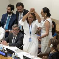 Costa Rican Ambassador Elayne Whyte Gomez, president of the United Nations conference on prohibiting nuclear weapons, celebrates after the meeting voted to adopt a legally binding ban on nuclear arms at United Nations headquarters in New York on Friday. | AP