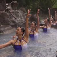Mikako Kotani (front) and other former Olympians perform synchronized swimming in an Oita Prefecture hot spring. | COURTESY OF OITA PREFECTURE