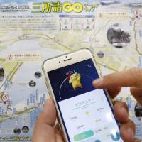 Popular Pokemon character Pikachu appears on the 'Pokemon Go' game app during a demonstration using a map of Amanohashidate in northern Kyoto Prefecture, one of Japan's most scenic spots. | KYODO