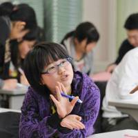 Japan's child poverty rate eases, but strong public support still needed