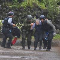 Rescuers race against time as flood death toll hits 18