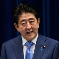 According to a poll published by the Mainichi Shimbun on Sunday, Prime Minister Shinzo Abe's support rating fell 10 points to 26 percent. | BLOOMBERG