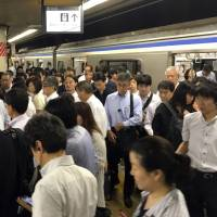 Tokyo plans new effort to ease commuter hell on rush-hour trains