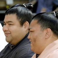 Wrestlers Takayasu (left) and Mitakeumi take part in a promotional event Saturday ahead of the start of the Nagoya Grand Sumo Tournament. | KYODO