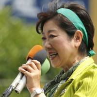 Tokyo begins voting in high-stakes battle pitting Abe's LDP against Koike-led party