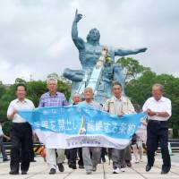Survivors of the 1945 atomic bombing of Nagasaki and their backers rally in Nagasaki Peace Park earlier this month to gain support for the world's first treaty banning nuclear weapons. | KYODO
