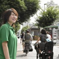Ayumi Saigo, 32, a member of Tomin First No Kai who is expecting a baby, campaigns in Tokyo's Chuo Ward on Monday a day after being elected to the Tokyo Metropolitan Assembly. | KYODO