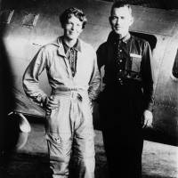 Amelia Earhart and her navigator, Fred Noonan, pose for a photo in front of their twin-engine Lockheed Electra in Los Angeles at the end of May 1937. | AP