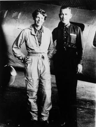 Amelia Earhart and her navigator, Fred Noonan, pose for a photo in front of their twin-engine Lockheed Electra in Los Angeles at the end of May 1937.