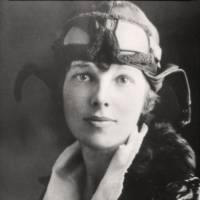 U.S. aviatrix Amelia Earhart poses for a portrait in her flying gear in an undated photograph. | PUBLIC DOMAIN