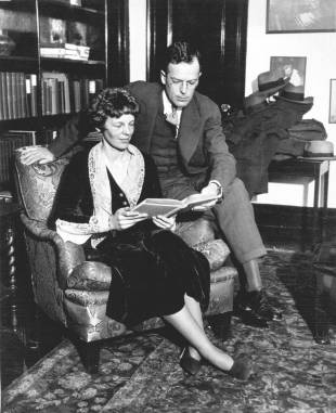 Amelia Earhart and her husband, George P. Putnam, relax at home in 1931.