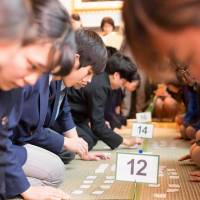 Eyes on the cards: School students compete at a karuta tournament held in January at the U.S. Embassy in Tokyo.