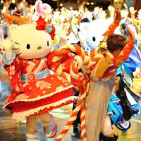 The cat's meow: Characters from Sanrio's Hello Kitty series take part in a nighttime  odori (dance) at a previous Puroland festival. | ©2017 SANRIO CO., LTD.